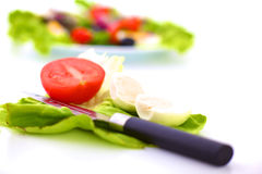 Fresh vegetables with a knife on the table for salad preparation Royalty Free Stock Images