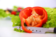 Fresh vegetables with a knife on the table for salad preparation Stock Photography
