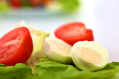 Fresh vegetables with a knife on the table for salad preparation Royalty Free Stock Photography