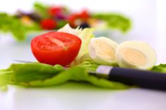 Fresh vegetables with a knife on the table for salad preparation Stock Photo