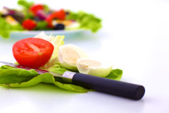 Fresh vegetables with a knife on the table for salad preparation Royalty Free Stock Image