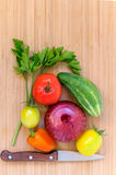 Fresh vegetables. And knife on wooden board Stock Photo