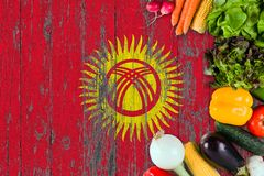 Fresh vegetables from Kyrgyzstan on table. Cooking concept on wooden flag background royalty free stock image