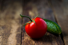 Fresh vegetables lay on the background of wooden boards Stock Photo