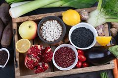 Fresh vegetables and legumes in wooden box. Stock Photography