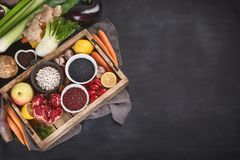 Fresh vegetables and legumes in wooden box. Royalty Free Stock Photography