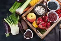 Fresh vegetables and legumes in wooden box. Stock Photos