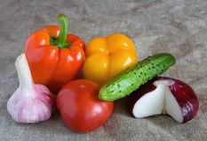 Fresh vegetables lie on linen cloth. Still life Stock Photography