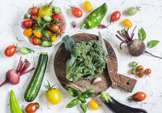 Fresh vegetables on a light background - broccoli, tomatoes, peppers, beets, eggplant, radish. Vegetarian table. Stock Photos
