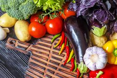 Fresh vegetables lying on an old wooden board Royalty Free Stock Photography