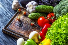Fresh vegetables lying on an old wooden board Royalty Free Stock Image
