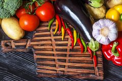 Fresh vegetables lying on an old wooden board Stock Photography