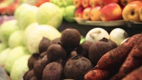 Fresh vegetables on the market. Fresh vegetables and fruits on the shelves farm market. Carrots, beets, cabbage stock video footage