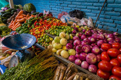 Fresh vegetables on market with old scale. Fresh vegetables with old scale sold on Otavalo market, Ecuador Royalty Free Stock Photography