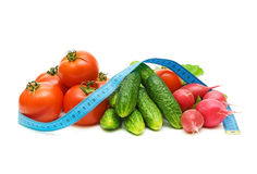 Fresh vegetables and a measuring tape Royalty Free Stock Photos