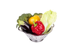 Fresh vegetables in metal colander Stock Photos