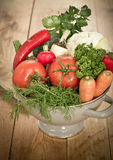 Fresh vegetables in metal colander. On the table Royalty Free Stock Image