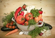 Fresh vegetables in metal colander. On the tablr Royalty Free Stock Photography