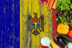 Fresh vegetables from Moldova on table. Cooking concept on wooden flag background stock photos