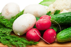 Fresh vegetables and mushrooms on the board Stock Photography