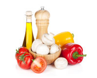 Fresh vegetables and mushrooms with olive oil and pepper shaker Royalty Free Stock Image