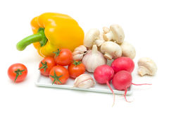 Fresh vegetables and mushrooms on a white background Stock Photos