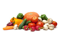 Fresh vegetables and mushrooms on a white background Stock Images