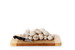 Fresh vegetables mushrooms, wooden chopping board. stock photos