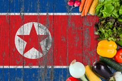 Fresh vegetables from North Korea on table. Cooking concept on wooden flag background stock photo
