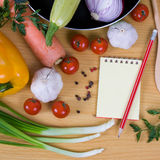Fresh vegetables and a notebook Stock Photos