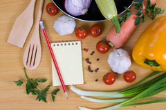 Fresh vegetables and a notebook Royalty Free Stock Photography