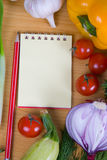 Fresh vegetables and a notebook Stock Photo