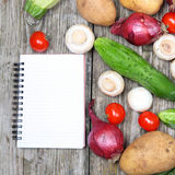 Fresh vegetables and a notebook for recipe Stock Photos