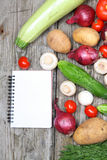 Fresh vegetables and a notebook for recipe Royalty Free Stock Image