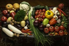 Fresh vegetables and nuts on the table royalty free stock photos