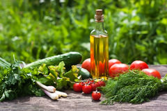 Fresh vegetables and oil. On the old table Royalty Free Stock Images