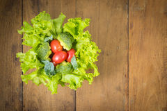Fresh vegetables. On the old wooden board Royalty Free Stock Images