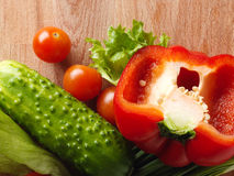 Fresh vegetables on the old wooden board. Stock Photos