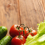 Fresh vegetables on the old wooden board. Stock Photo
