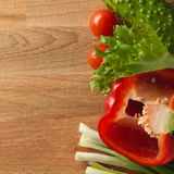 Fresh vegetables on the old wooden board. Royalty Free Stock Image
