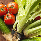Fresh vegetables on the old wooden board. Stock Images