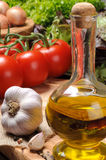 Fresh vegetables with olive oil Stock Images
