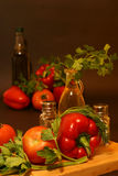 Fresh vegetables olive oil. Fresh raw vegetables and olive oil on dark background Stock Photography