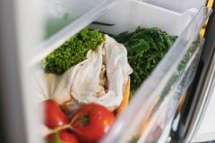 Fresh vegetables in opened drawer in refrigerator. Plastic free carrots,tomatoes, mushrooms,onions, radish,salad, arugula from. Market in fridge. Zero waste stock image