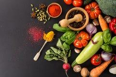 Fresh vegetables. Fresh organic seasonal garden vegetables for cooking on black background royalty free stock images