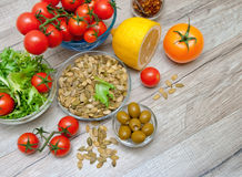 Fresh vegetables and other food on a wooden background Royalty Free Stock Photography