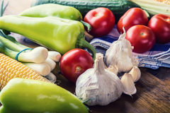 Fresh vegetables. Overhead view of a assortment of farm fresh vegetables, Green pepper, garlic, corn, onions, tomatoes, cucumbers Stock Photo