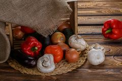 Fresh vegetables in overturned wooden box with burlap stock images