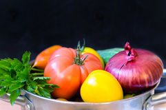Fresh vegetables. In pan on black  background Royalty Free Stock Images