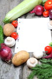 Fresh vegetables and a paper for recipe Royalty Free Stock Photography